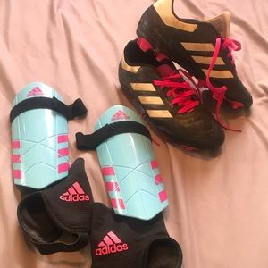 Girls soccer cleats and shin pads
